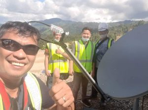 VSAT installers with a dish